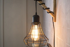 Hanging-Cage-Light-on-Chalkboard-Wall