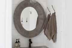 bathroom-vanity-and-oval-mirror