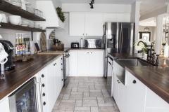 white-farmhouse-kitchen-shiplap-backsplash-butcher-block