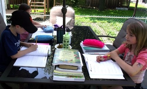homeschooling without a school room kids outside at the patio table