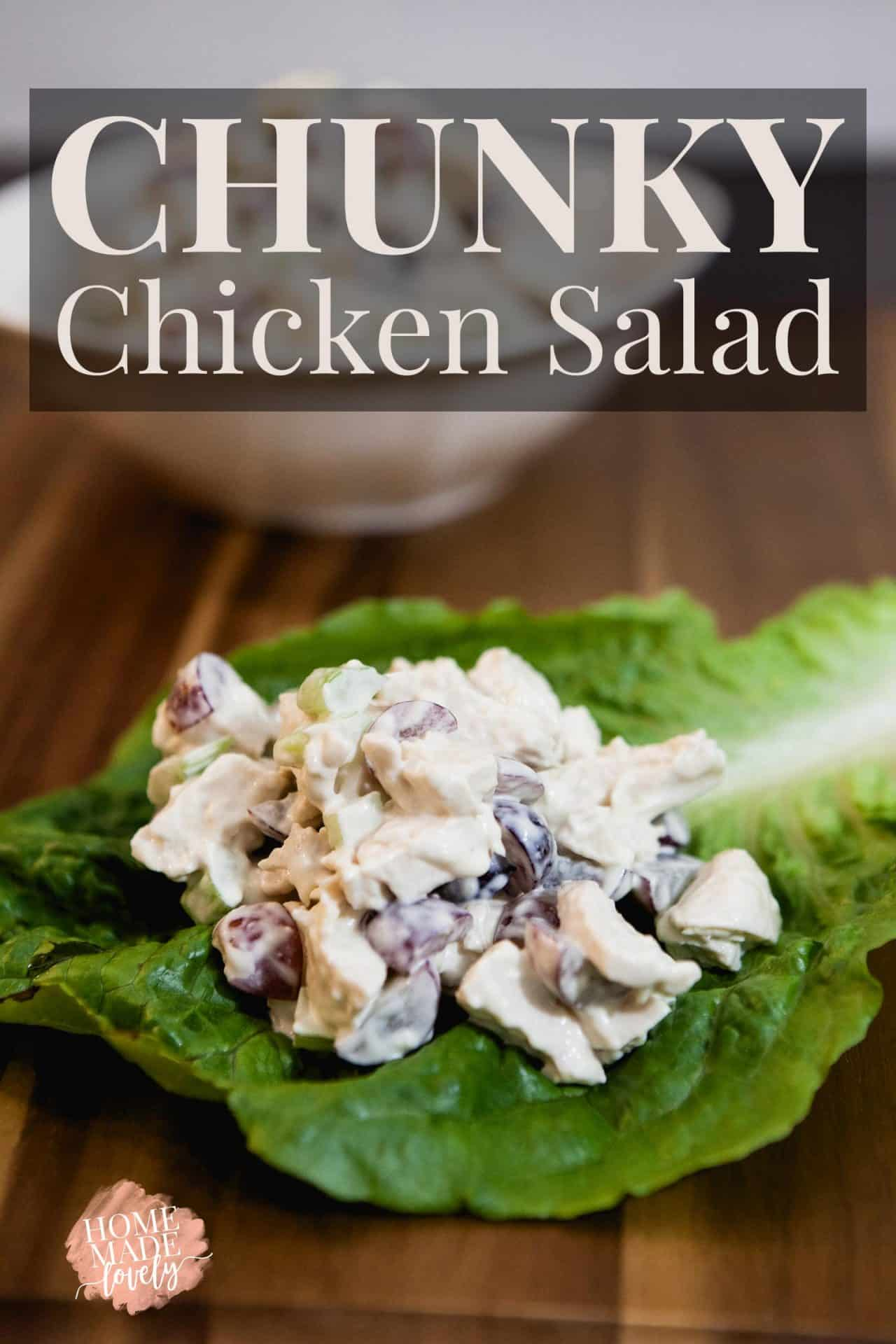 Chunky chicken salad in a lettuce wrap on a wood counter