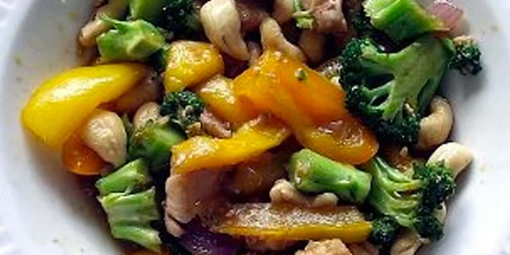 mango cashew chicken stir fry in a bowl