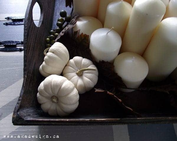 mini boo white pumpkins and candles up close