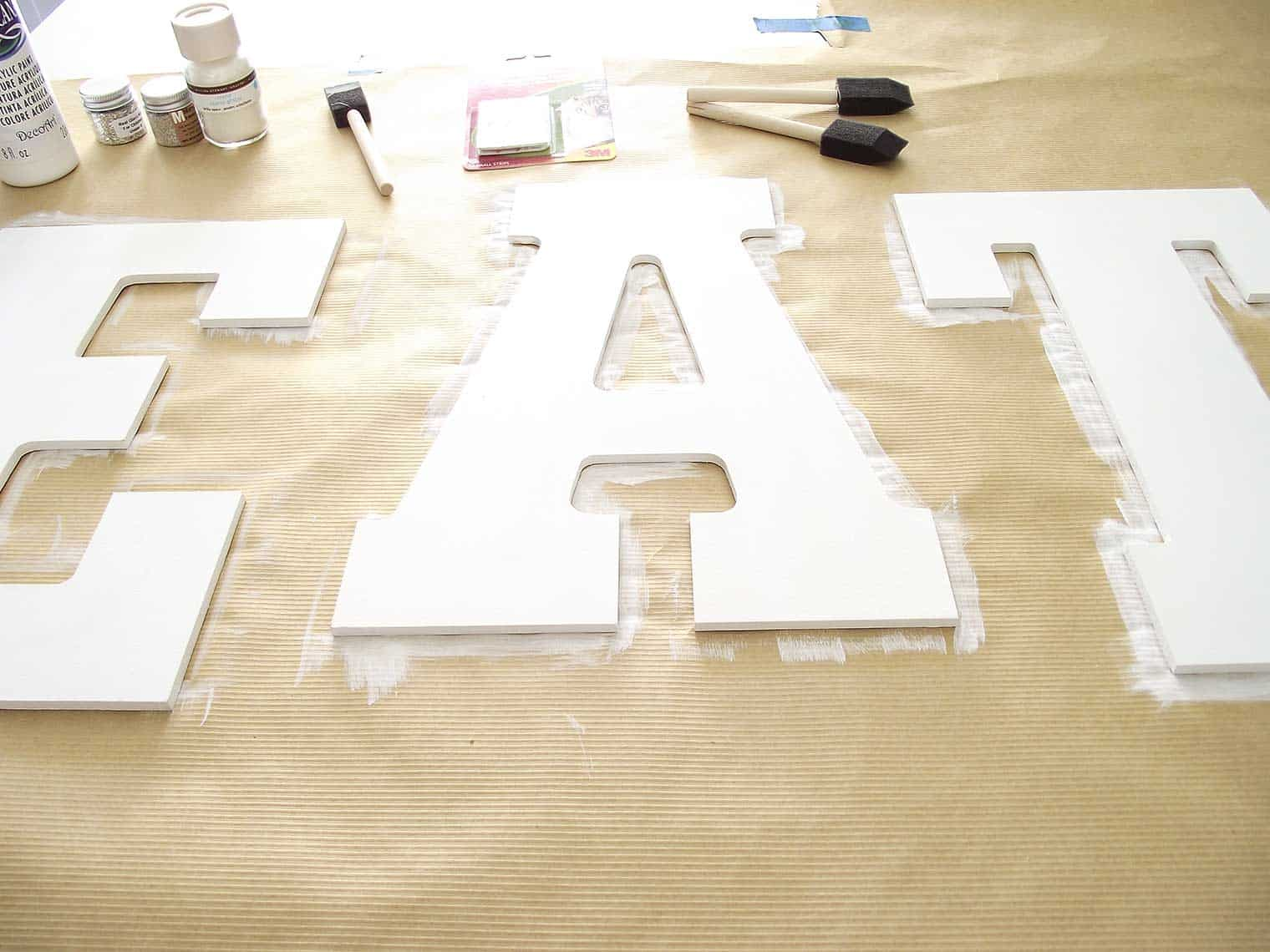white painted letters on Kraft paper