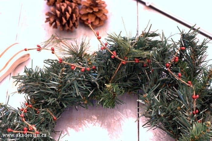pinecone and rusty jingle bell wreath pip berries