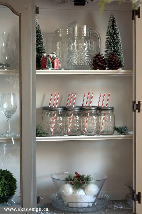 christmas decorated hutch bottle brush trees snow