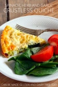 egg quiche on plate with spinach and tomato