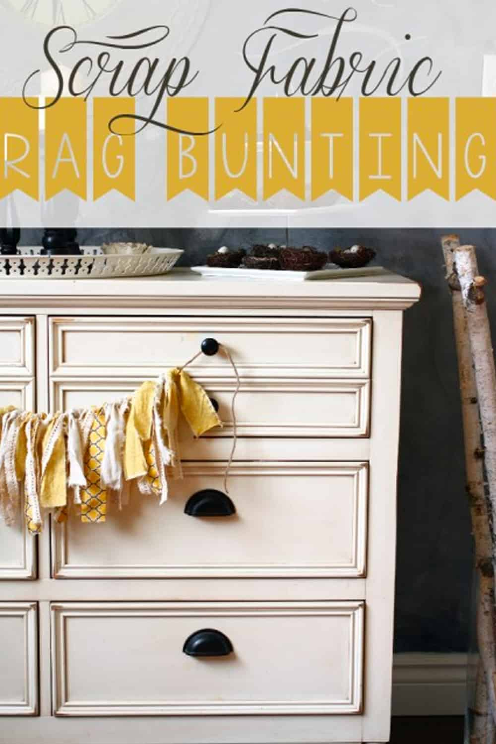 dresser with yellow and cream scrap fabric rag bunting hanging from it
