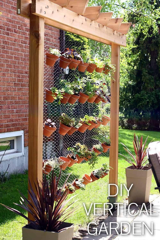 How to build your own diy vertical garden wall for Diy garden designs