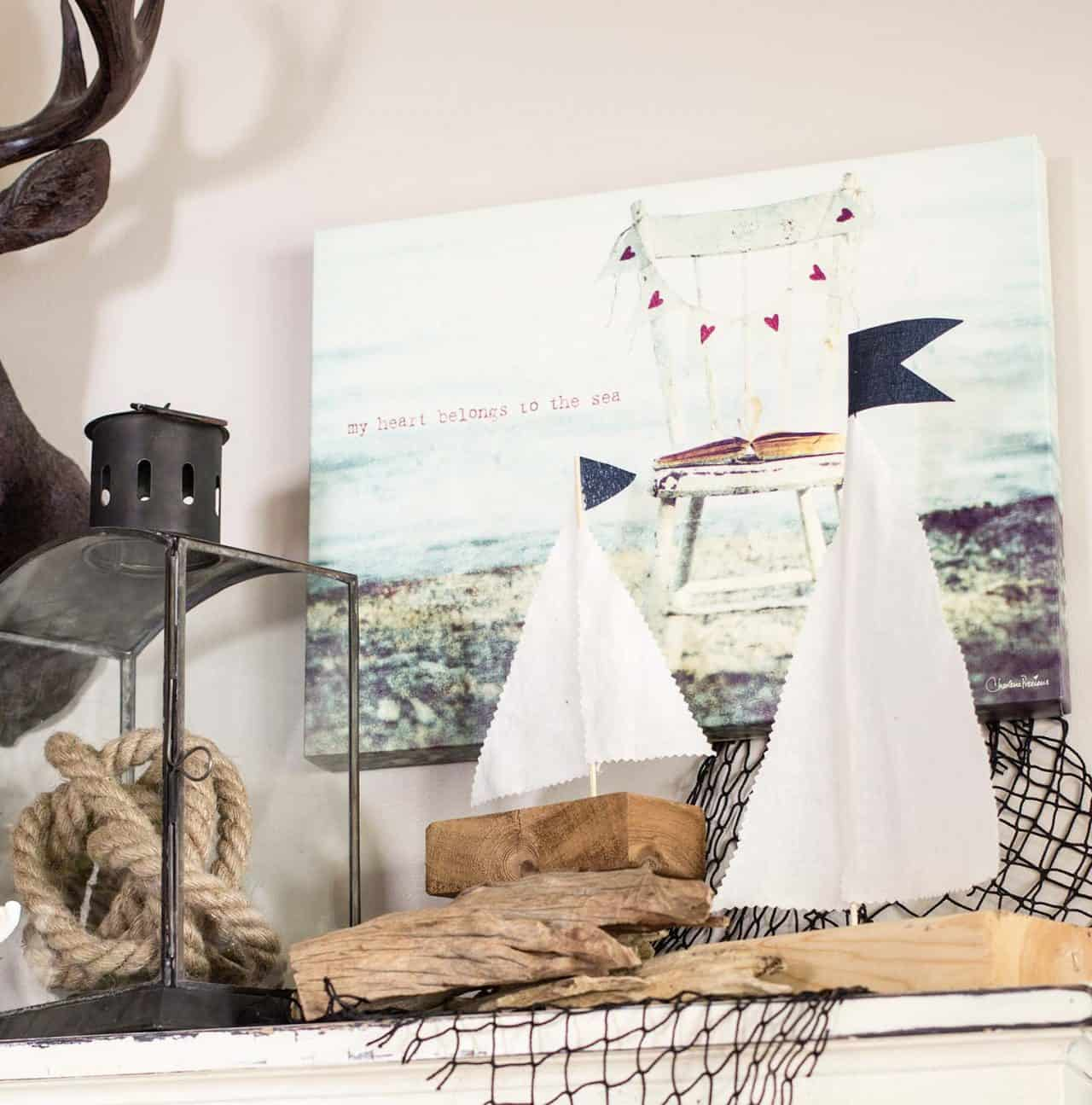 DIY wood sailboats on shelf with lantern, fishing net, rope, etc as decor