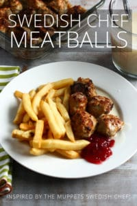 meatballs, berry sauce and french fries on a plate