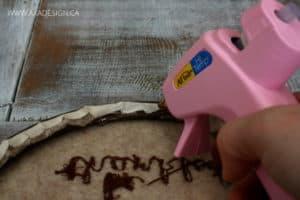 hot glue hoop art fabric to back