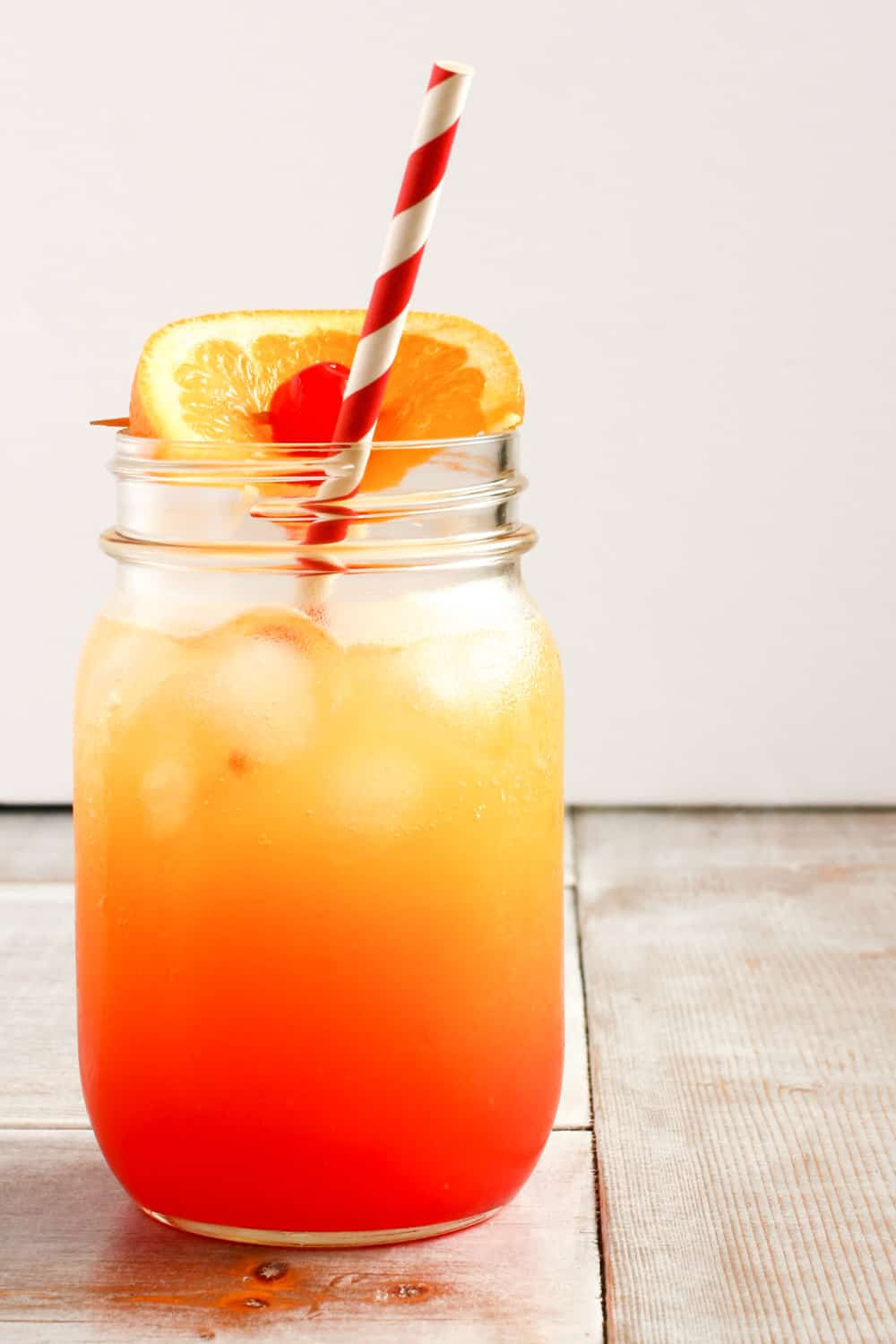 shirley temple, orange slice, cherry, red striped straw