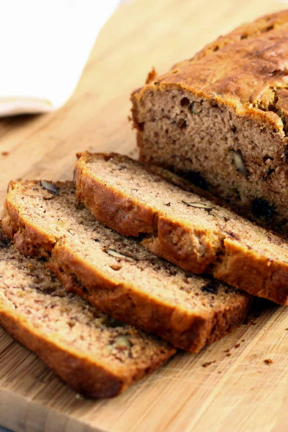 Gluten free banana bread recipe banana bread slices on wood cutting board forumfinder Gallery