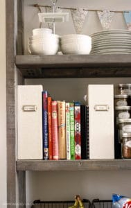 recipe books on open pantry