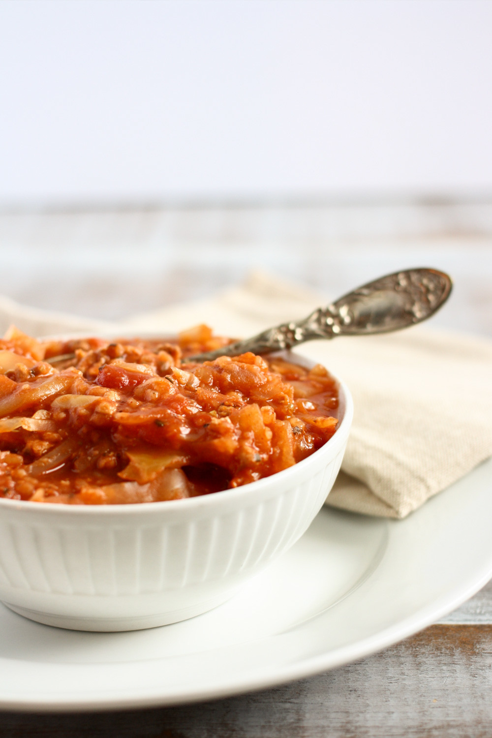 cabbage casserole in a bowl with a vintage spoon