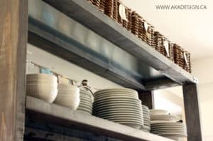 white dishes and baskets on open kitchen shelving