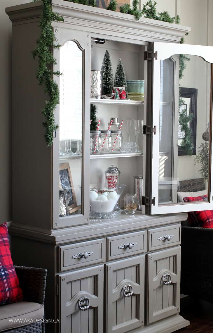 Decorating a dining room hutch for christmas for Dining room hutch decor