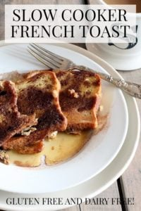 french toast on a plate, S mug, antique fork