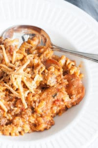 pasta with sauce in a bowl, with a spoon