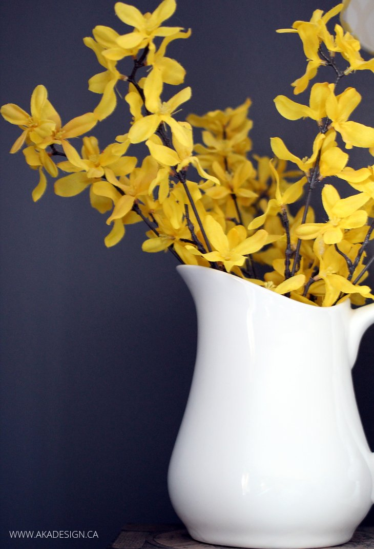 YELLOW FLOWERS WHITE PITCHER GREY WALL