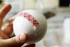 Hot glue fabric to styrofoam ball