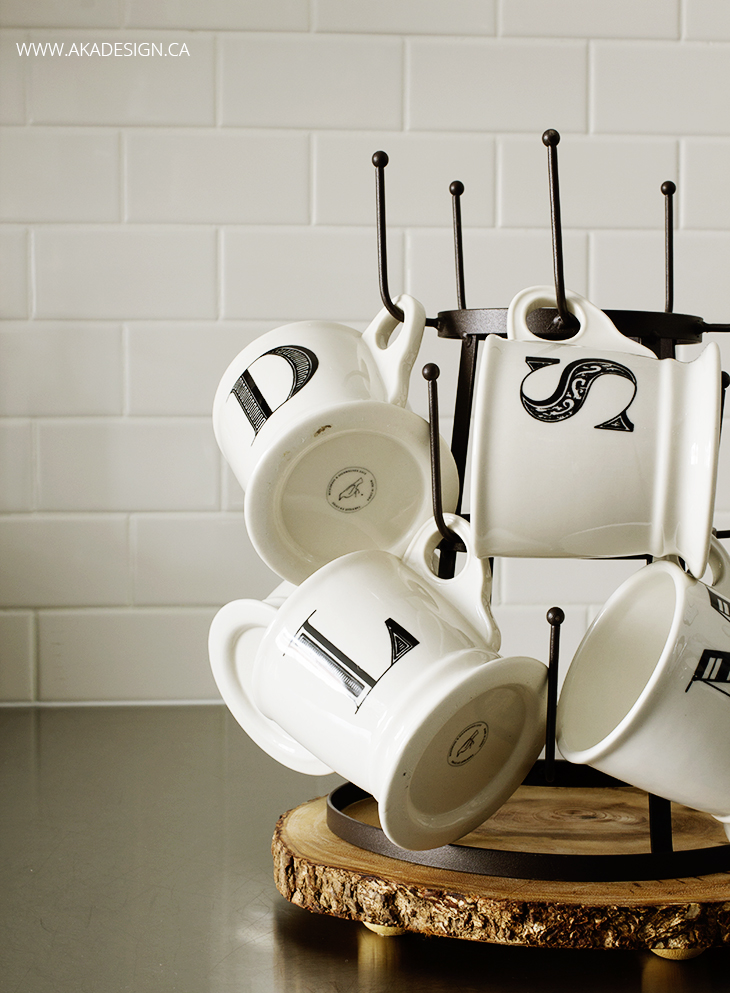 Monogram mugs, bottle drying rack, subway tile, stainless counter