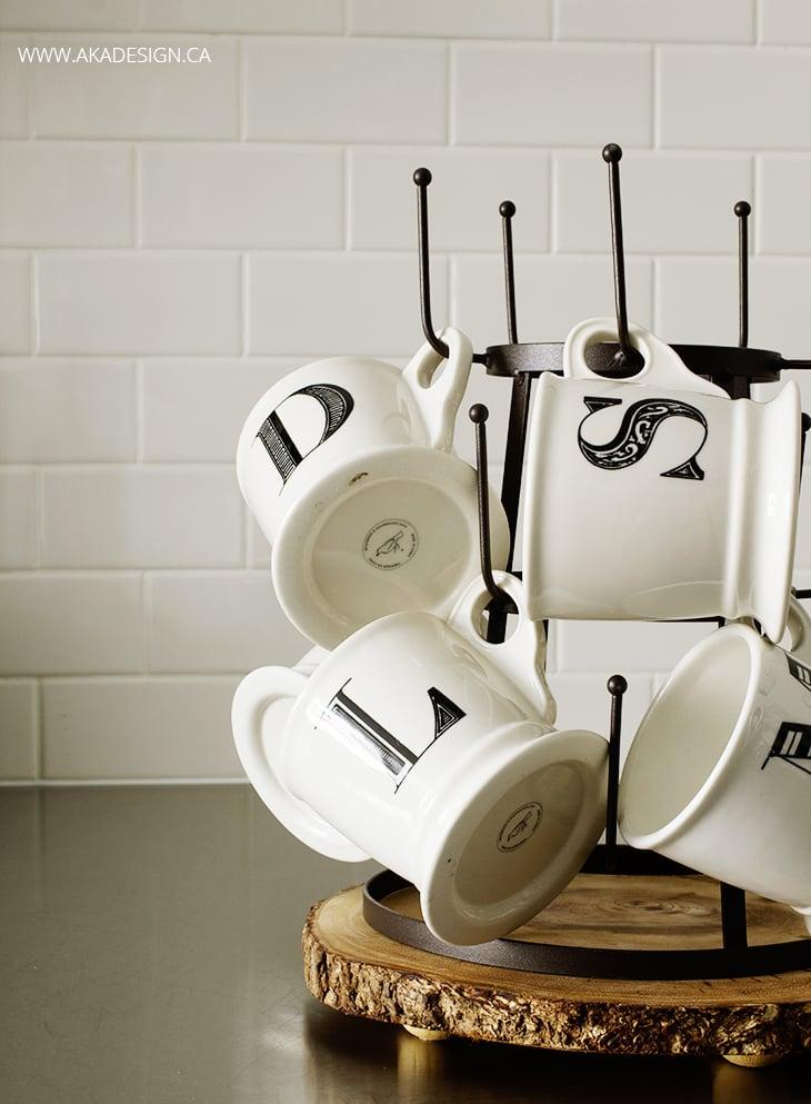 Monogram mugs, bottle drying rack, subway tile, stainless counter