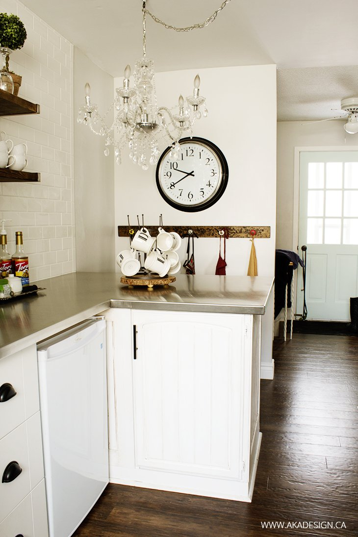 Open Shelves, mini fridge, breakfast bar, large wall clock