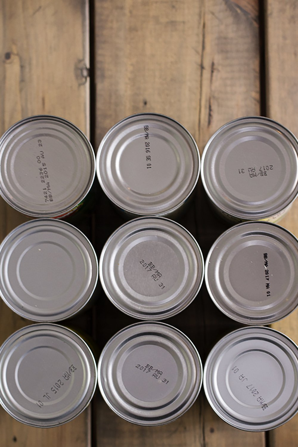 cans on wood table