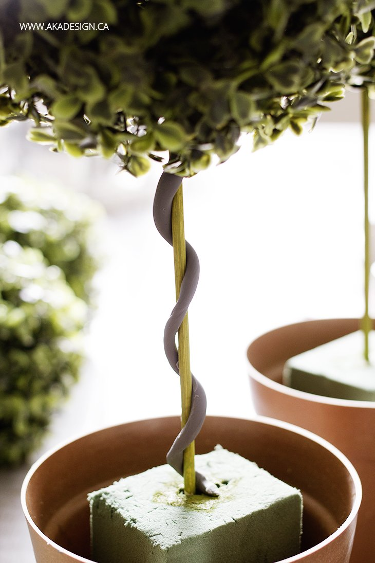 rolled modelling clay as vine on diy topiary