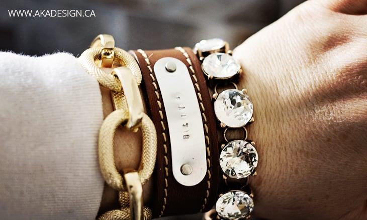 metal stamped tag on leather bracelet