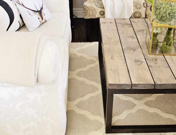 rustic industrial coffee table trellis rug white couch