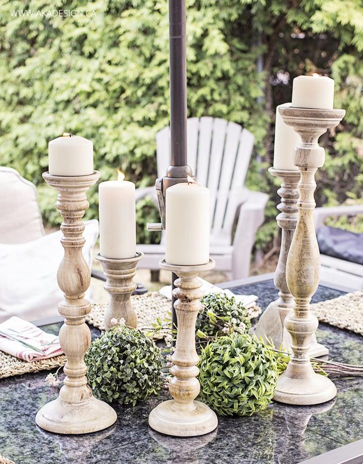 pillar candle sticks on outdoor patio