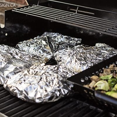 potato packets and veggies on bbq grill