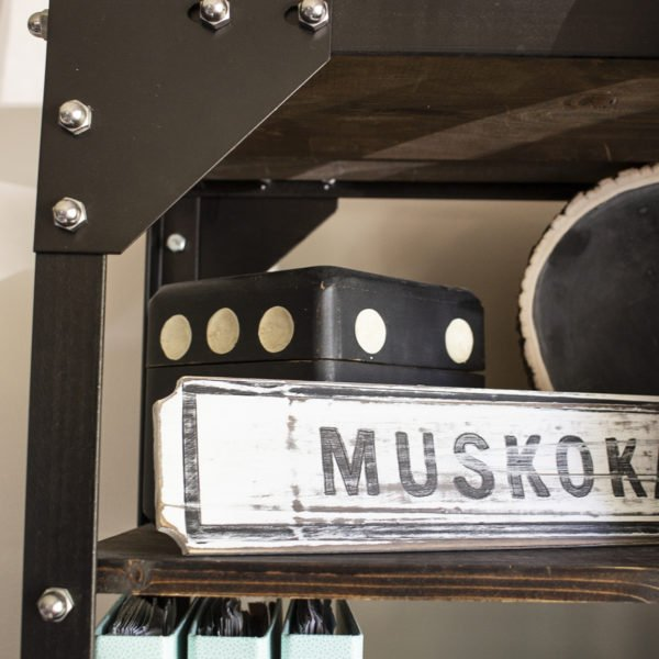 Muskoka sign on rustic wood and metal shelves