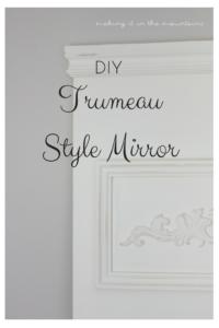 white mirror with detailed trim