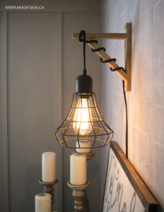 Hanging Cage Light on Chalkboard Wall