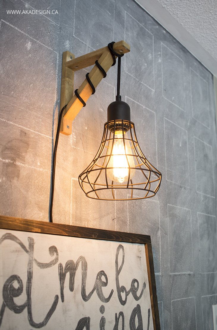 Hanging Cage Light From A Plug In Light And A Wood Bracket