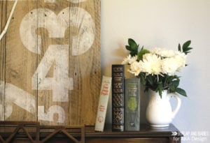 Oversized Rustic Clock | Create this dramatic oversized rustic wall clock using some old fence boards and paint. Get the full tutorial here!
