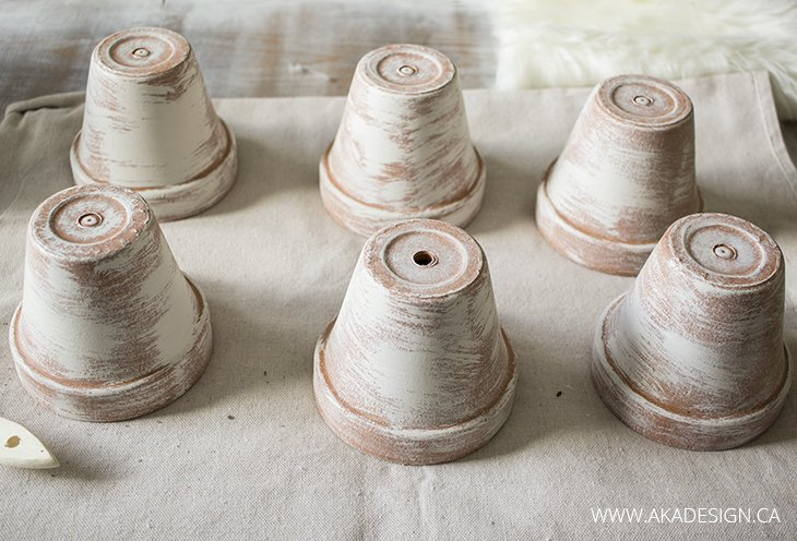 painting clay pots to age them