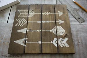 paint marker arrows on wood plaque