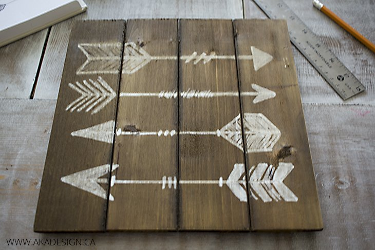 paint marker arrows on wood plaque