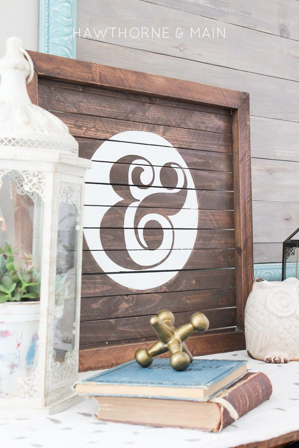 wood slat sign with ampersand painted on it 13