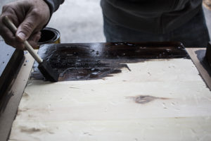 Apply stain to wood