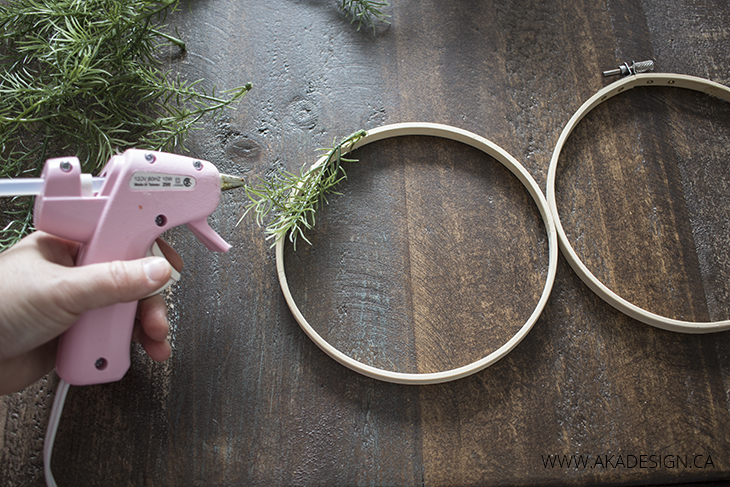 Glue faux greenery onto hoop circle