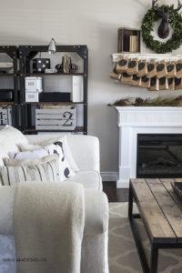 AKA Design living room shelves couch fireplace