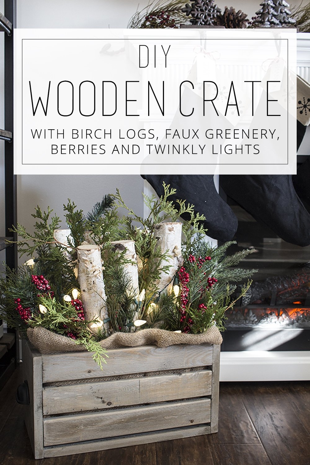 diy wooden crate with logs, greenery and lights