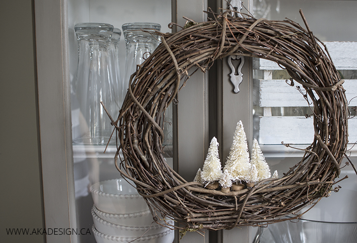 rustic holiday wreath with bottle brush trees