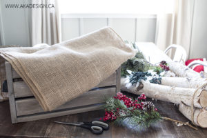 wooden crate, logs and greenery supplies